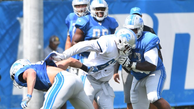 Defensive end Kerry Hyder Jr. battles with tight end Cole Wick and tackle Greg Robinson during defensive and offensive line drills on Tuesday.