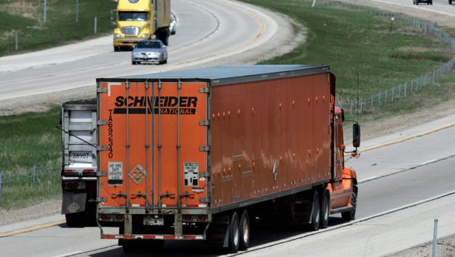 A Schneider National truck makes its way on I-43 Northbound near Hwy 60 in Grafton. November 2008.