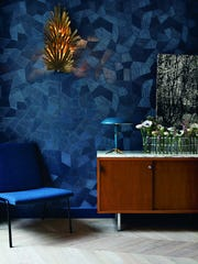 """This undated photo provided by The Monacelli Press of Paris' Hotel Henriette features a dramatic modern dining space which has a dark graphic wallpaper from Arte. The tone-on-tone pattern adds visual interest without the distraction of multiple colors. The photo is featured in the book """"Hotel Chic at Home"""" by Sara Bliss."""