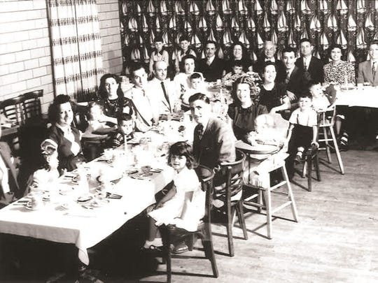 A photo of Josie Gaydos' family having dinner circa 1950.