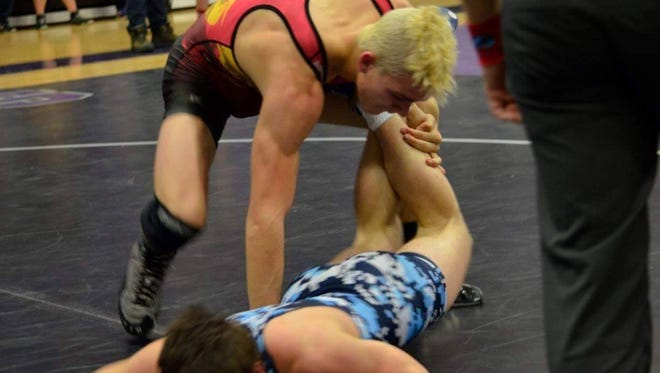 Enka junior Kamron, top, McClellan has been invited to wrestle in the Down Under Sports freestyle championship tournament this summer in Australia.