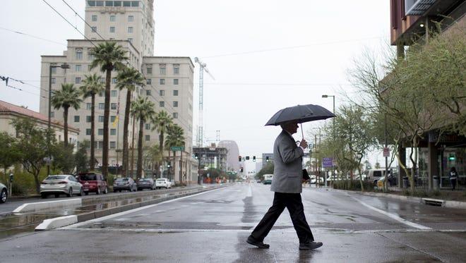 Rain creates a soggy Valentine's Day 2018 in downtown Phoenix.