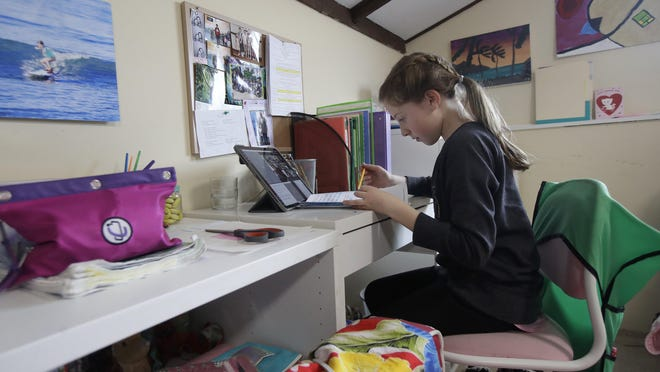 A 9-year-old girl takes a live class online at her home in San Francisco. California's Bay Area was the first region of America to order its residents to stay home, work remotely and homeschool their children in a desperate bid to slow the spread of the coronavirus.