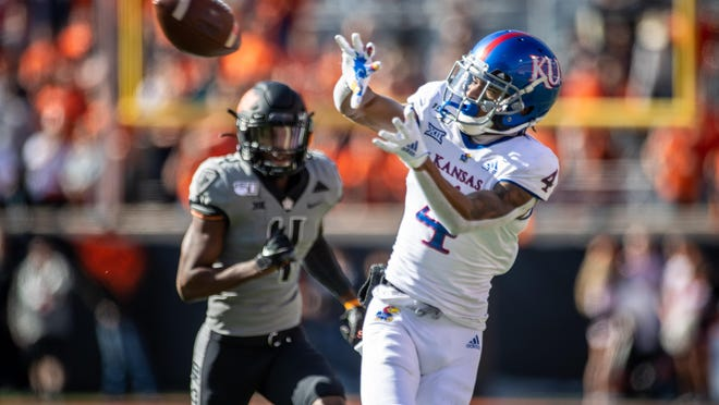 Kansas wide receiver Andrew Parchment, right, and the Jayhawks will kick off their season with a 9 p.m. Saturday opener against Coastal Carolina at David Booth Kansas Memorial Stadium in Lawrence.