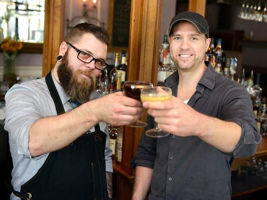 Pour Me Another host Mike Thiel, right, meets and speaks with bartender Andrew Hannigan, on left, at Holland House Bar & Refuge in East Nashville on Thursday April 7, 2016 in Nashville. Hannigan highlights his signature drink, the Double Barrel Titan.