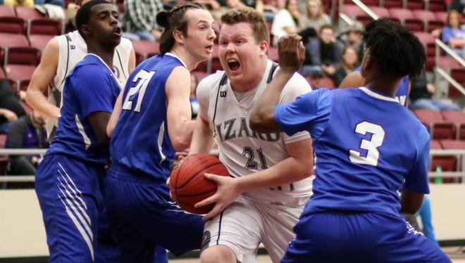 Izard County's Mike Uecker drives to the basket against Nevada on Wednesday night at Morrilton.