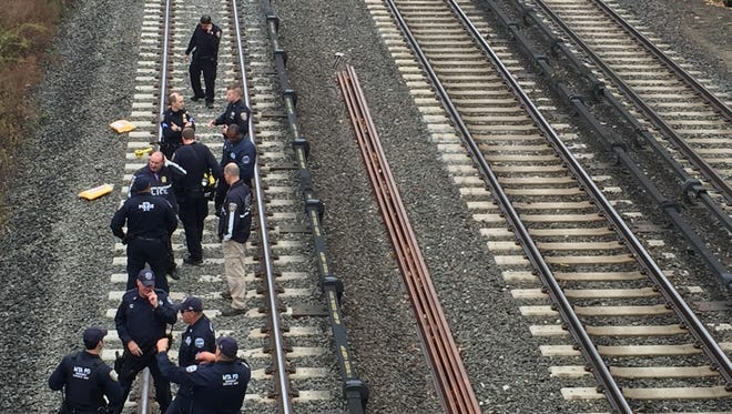 A person was struck by a Harlem Line train south of the Bronxville station early Thursday morning. Authorities investigate the scene just north of the Midland Avenue overpass, on Thursday, Nov. 5, 2015.