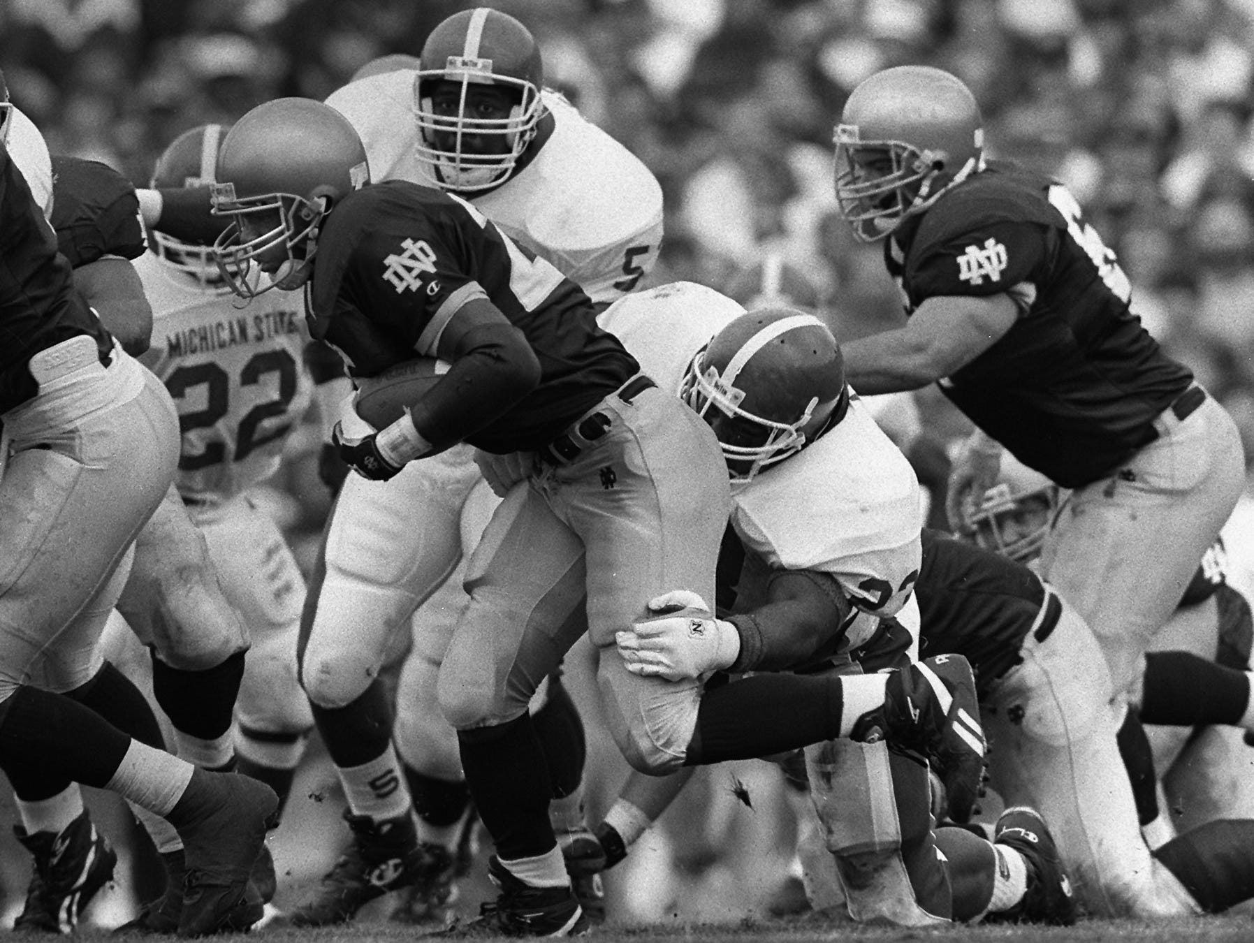 Randy Kinder runs the ball against Michigan State on Sept. 18, 1993 in South Bend, Indiana. The Irish won 36-14 on their way to a No. 2 national finish that season. Kinder, from East Lansing, rushed for 537 yards as a true freshman that season.