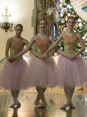 Ballerinas perform a dance for the tour group during