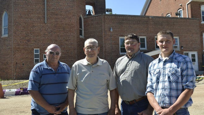 From left, Larry Vanness, Harlin Mercier, Kevin Mercier and Joe Mercier stand outside the chapel at The Shrine of Our Lady of Good Help in Champion. They have volunteered at the shrine together for about 25 years, ringing the bell that sits atop the chapel. Harlin Mercier, 78, has been a bell ringer at the shrine for nearly 70 years, getting help along the way from his son Kevin, grandson Joe and Vanness.