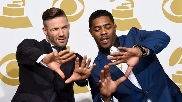 New England Patriots'  Julian Edelman, left, and Malcolm Butler were presenters at the Grammy Awards Sunday night.