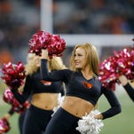 Oregon State cheerleaders perform during the second half of an NCAA college football game, in Corvallis, Ore., on Saturday, Oct. 24, 2015. (AP Photo/Timothy J. Gonzalez)