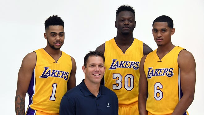 Luke Walton poses with D'Angelo Russell, Julius Randle and Jordan Clarkson at media day at Toyota Sports Center.
