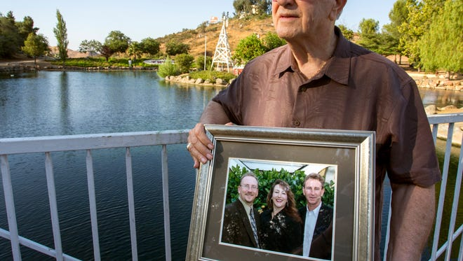 Frank Kerrigan holds onto a photograph of his three children John, Carole, and Frank, near Wildomar. Kerrigan, who thought his son Frank had died, learned he buried the wrong man. Kerrigan said the Orange County coroner's office mistakenly identified a body found dead on May 6 as that of his son.