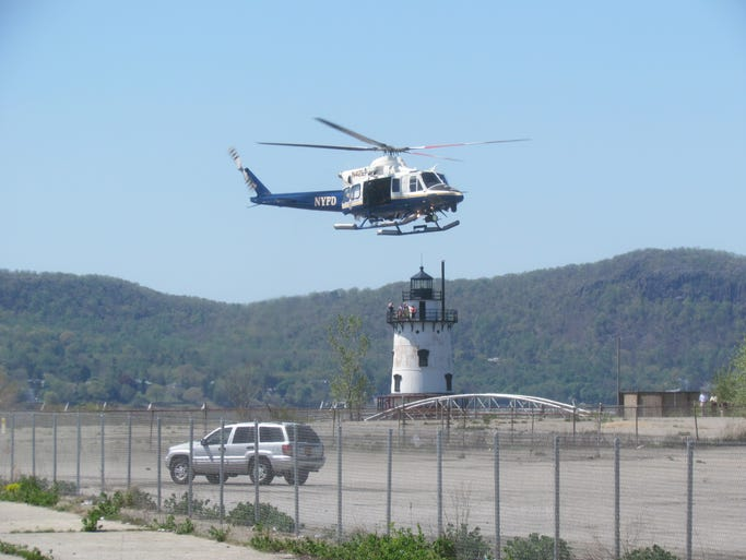 An NYPD helicopter escorting President Obama's advance team lands at the former GM site near the Sleepy Hollow lighthouse.
