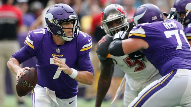 Minnesota Vikings quarterback Case Keenum (7) throws a pass during the second half of an NFL football game against the Tampa Bay Buccaneers, Sunday, Sept. 24, 2017, in Minneapolis.