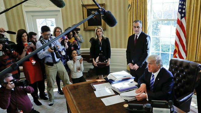 President Donald Trump, speaks to members of the media during a meeting in the Oval Office of the White House. Trump's unconventional approach and public disdain for the media have made for fireworks early in his administration. (AP Photo/Pablo Martinez Monsivais)