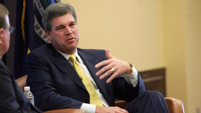 Michigan athletic director Dave Brandon, right, talks with Jim Brandstatter on Aug. 25, 2010.