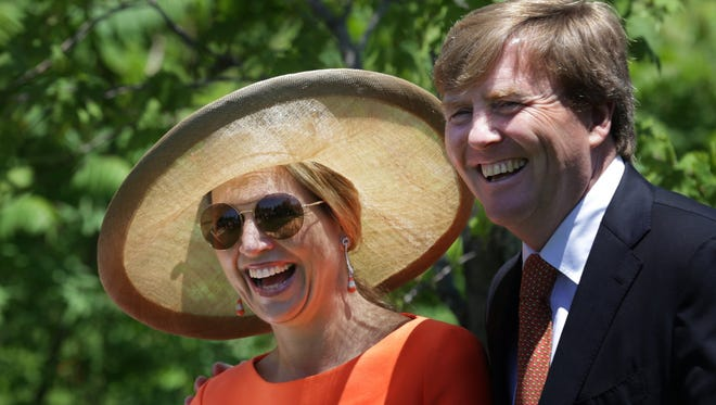 King Willem-Alexander and Queen Maxima of the Netherlands at the Frederik Meijer Gardens & Sculpture Park in Grand Rapids today during a tree-planting ceremony.