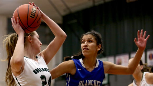 Blanchet's Ana Coronado (23) tries to block Salem Academy's Sydney Brown (24) in the Blanchet vs. Salem Academy girl's basketball game at Salem Academy High School on Thursday, Jan. 14, 2015. Blanchet won the game 56-43.