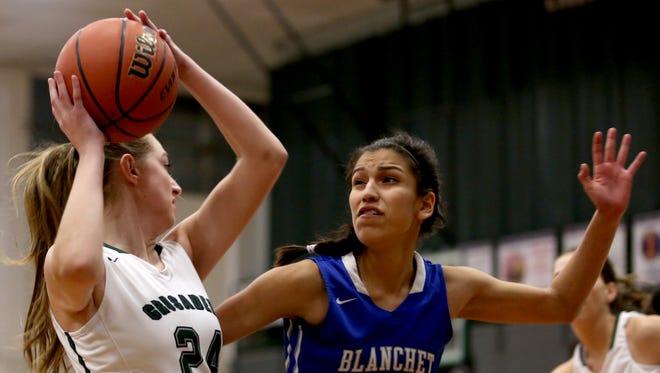 Blanchet's Ana Coronado (23) tries to block Salem Academy's Sydney Brown (24) in the Blanchet vs. Salem Academy girl's basketball game at Salem Academy High School on Thursday, Jan. 14, 2015. Blanchet won the game 56-43.