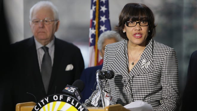 Flint mayor Karen Weaver calls for the immediate removal of all lead pipes from the city's water distribution system during a news conference at Flint City Hall on Tuesday.