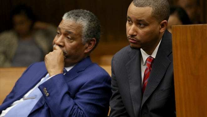 Attorney Godfrey Dillard and his client State Sen. Virgil Smith, listen as Judge Lawrence Talon speaks in his courtroom at the Frank Murphy Hall of Justice in Detroit. Smith will serve 10 months in jail with no early release and comply with psychiatric, alcohol and drug counseling, but does not have to give up his senate seat.