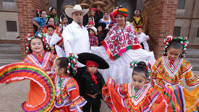 El Ballet Folklorico Moyocoyani Izel president Maria Luisa Carrillo and lead dance instructor Jaime Carrillo pose for a photo outside of St. Gabriel Parish in Detroit in November 2015 with members of the dance company. They received a grant from the Knight Foundation as part of it's investing an additional $9 million into Detroit's cultural scene to renew the Knight Arts Challenge program for an additional three years.