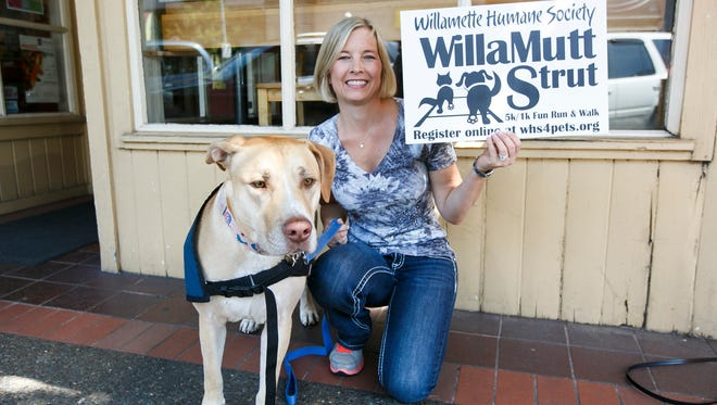 Labrador retriever mix Felicity brought Willamette Humane Society volunteer Krystal Kraig to Holding Court to reminder us about the WillaMutt Strut on June 12 at Riverfront Park.