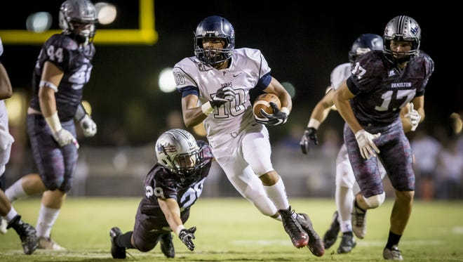 Perry's wide receiver Nate James (10) runs the ball in the second half at Hamilton High School on Friday, October 21, 2016.