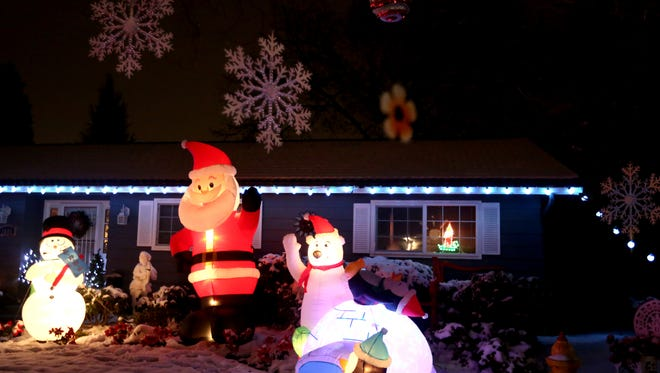 A home is lit up for the Keizer Miracle of Christmas lights display on Sunday, Dec. 18, 2016. The event continues nightly through Dec. 26 and features hundreds of illuminated homes and a food drive for the Marion-Polk Food Share.