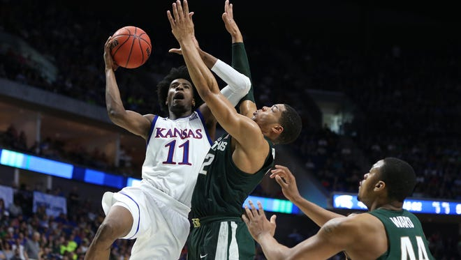 Kansas forward Josh Jackson goes up for a shot as Michigan State forward Miles Bridges defends during the second half of MSU's 90-70 loss Sunday, March 19 in the 2017 NCAA tournament in Tulsa, Okla.