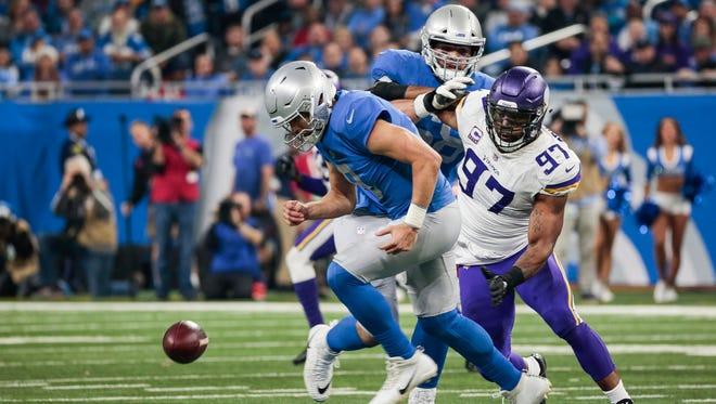 Lions' Matthew Stafford and Vikings' Everson Griffen try to recover a fumble in the second half Nov. 23.