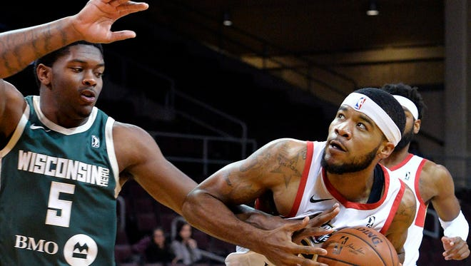Wisconsin Herd forward Cameron Oliver, left, fouls Erie BayHawks forward Jeremy Hollowell in the first half of an NBA G League basketball game in Erie, Pa.