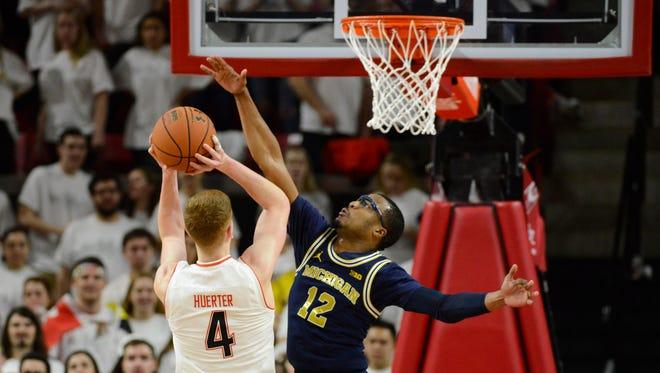 Michigan's Muhammad-Ali Abdur-Rahkman defends Maryland's Kevin Huerter during the first half at XFINITY Center on Saturday.