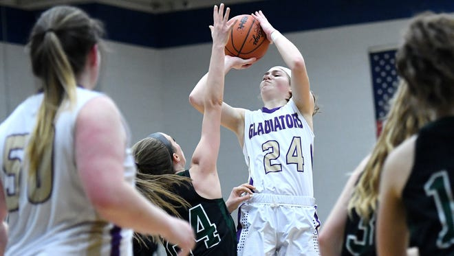 Fowlerville senior Elie Smith (24) is an all-county first-team selection who has signed with Cleveland State.