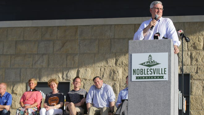 Indiana Gov. Eric Holcomb speaks at a prayer vigil held at Federal Hill Commons in Noblesville in Noblesville Saturday, May 26, 2018, a day after a shooting at Noblesville West Middle School injured a teacher and a student.