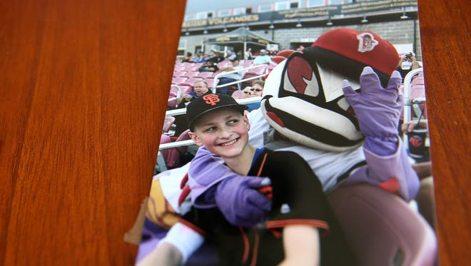 A photo of Jack Schumacher from a Volcanoes baseball game is shown on the kitchen table in his family's West Salem home on Friday, June 1, 2018. Schumacher died in May at age 14 from osteosarcoma, a form of bone cancer.