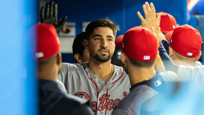Tigers right fielder Nicholas Castellanos (9) is greeted in the dugout by teammates after scoring during the first inning on Monday, July 2, 2018, in Toronto.