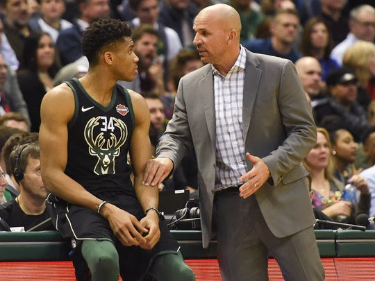 Mlwaukee Bucks head coach Jason Kidd talks to forward Giannis Antetokounmpo. Kidd wants more consistency from his team.