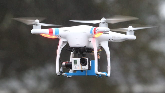 Vinny Garrison of FlyingFilmsNY flies a quadcopter drone at the Outdoor Education Center in Nanuet on Dec. 23.