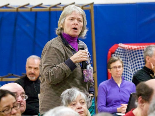 Former Richmond Selectboard member Mary Houle requests that the current Board do a better job of informing the public of ongoing budget balances during their regularly scheduled meetings throughout the year at the Camel's Hump Middle School on Tuesday.