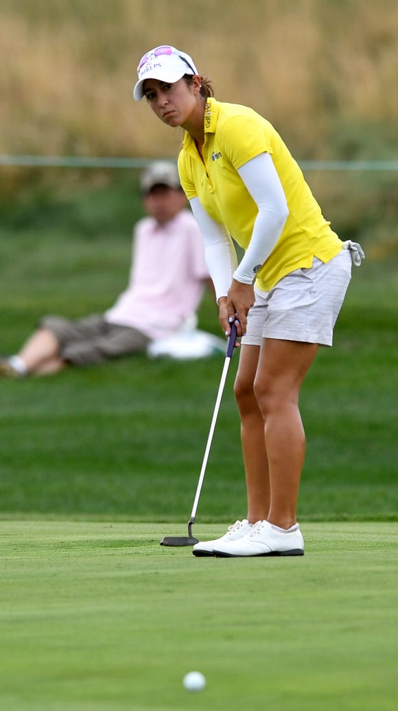 Marina Alex of Wayne putts on the tenth green during