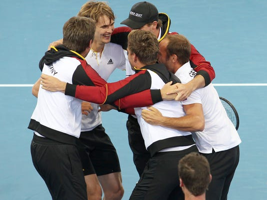 German team celebrate after compatriot Alexander Zverev, second from left, won over Nick Kyrgios of Australia at the Davis Cup World Group first round in Brisbane, Australia, Sunday, Feb. 4, 2018. (AP Photo/Tertius Pickard)