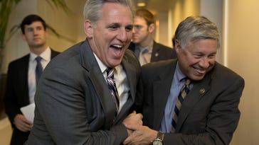 House Majority Leader Kevin McCarthy of Calif., left, and Rep. Fred Upton, R-Mich., laugh together as they walk from a meeting on Capitol Hill in Washington, Monday, Oct. 26, 2015.