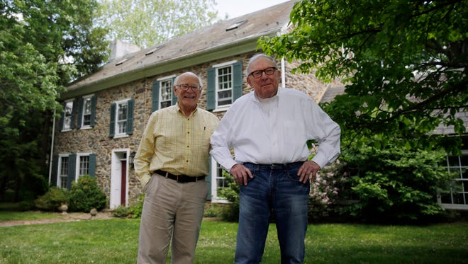 Bill Novak, right, and partner Norman MacArthur pose for a photograph at the couple's home, May 22, in Erwinna, Pa.