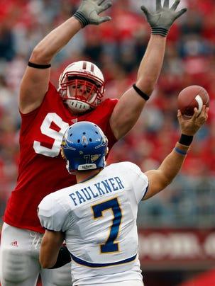 Wisconsin's J.J. Watt deflects a pass from San Jose