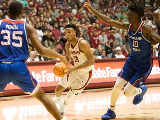 Nov 29, 2017; Tuscaloosa, AL, USA; Alabama Crimson Tide guard Dazon Ingram (12) goes to the basket against Louisiana Tech Bulldogs forward Anthony Duruji (10) and forward Oliver Powell (35) during the second half at Coleman Coliseum. Mandatory Credit: Marvin Gentry-USA TODAY Sports