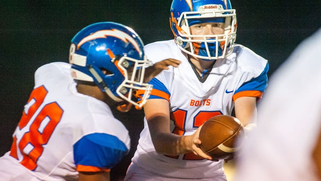 Millville qaurterback Tristan Harris (12) hands off to running back Clayton Scott (28) against Kingsway at Kingsway Regional High School in Woolwich on Friday, September 16.
