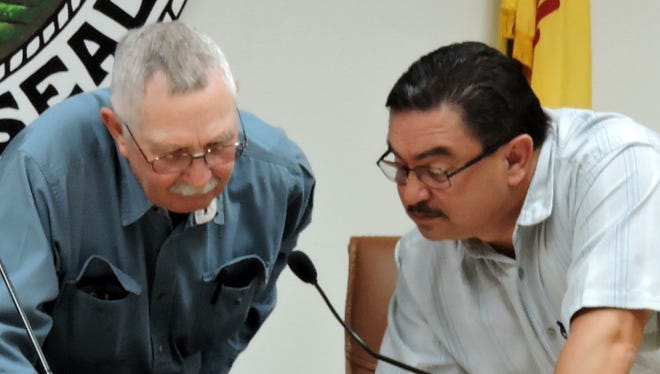 Vance Lee, left, of Hidalgo County, speaks with CAPE executive director, Anthony Gutierrez prior to the Tuesday, May 2 meeting.